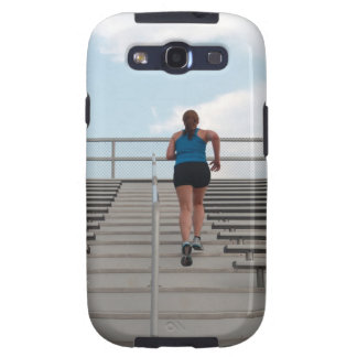 young woman running up steps galaxy SIII cover