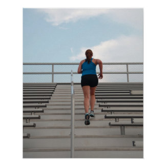 young woman running up steps posters