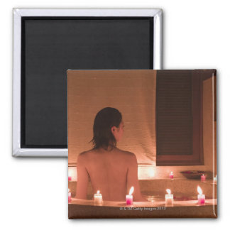 Young woman taking bath with flower petals 2 inch square magnet