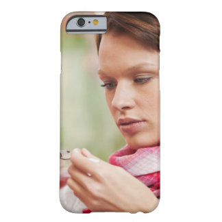 Young woman taking cough medicine barely there iPhone 6 case