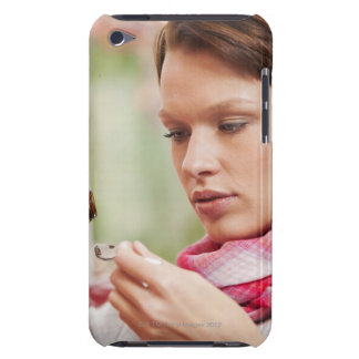 Young woman taking cough medicine barely there iPod case