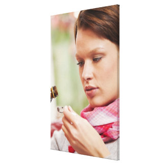 Young woman taking cough medicine canvas print