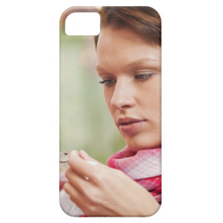 Young woman taking cough medicine iPhone 5 cases