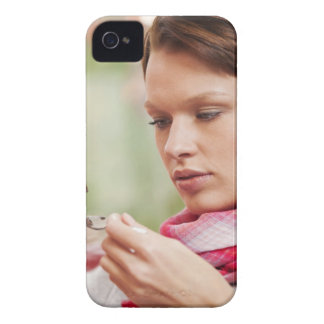 Young woman taking cough medicine iPhone 4 cover