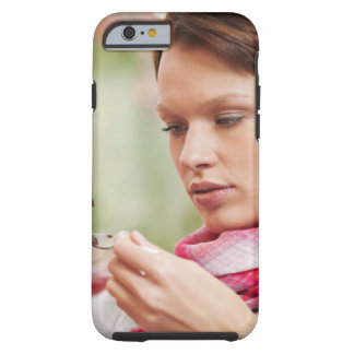 Young woman taking cough medicine tough iPhone 6 case