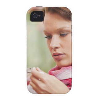 Young woman taking cough medicine vibe iPhone 4 covers