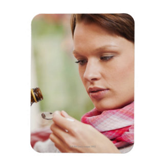 Young woman taking cough medicine flexible magnet
