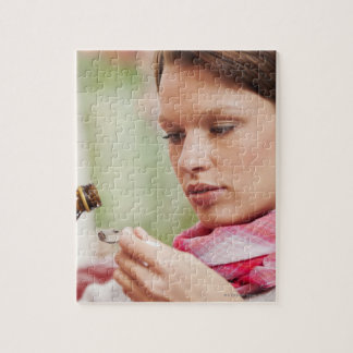 Young woman taking cough medicine jigsaw puzzle