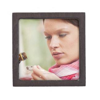 Young woman taking cough medicine keepsake box