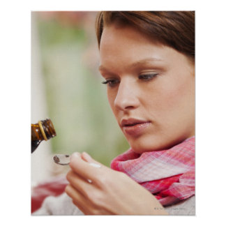 Young woman taking cough medicine poster