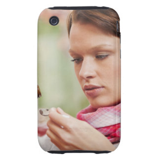 Young woman taking cough medicine tough iPhone 3 cover