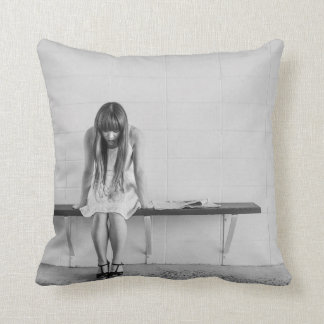 Young woman thinking throw pillows