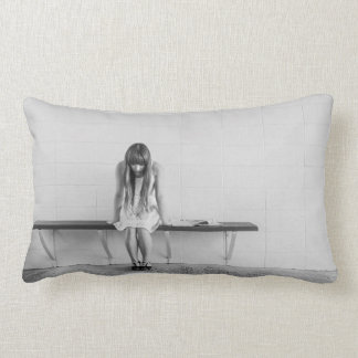Young woman thinking pillows