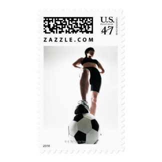 young woman training,football postage stamp
