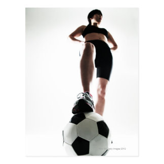 young woman training,football postcard