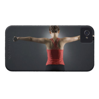 Young woman using dumbbells, rear view, studio iPhone 4 cover