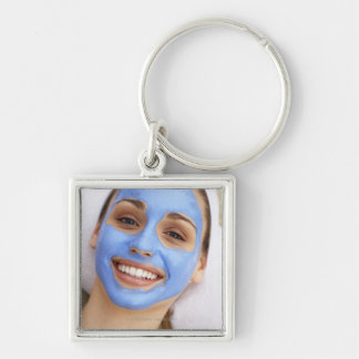 Young woman wearing facial mask, smiling, Silver-Colored square keychain