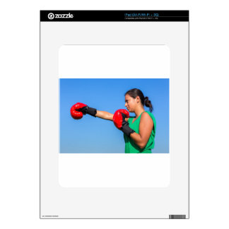 Young woman wearing red boxing gloves blue sky decals for the iPad