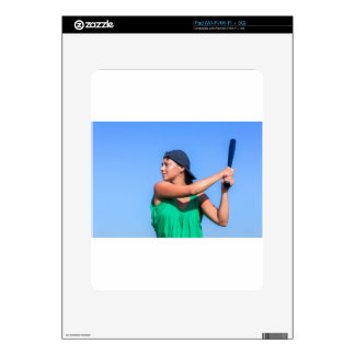 Young woman with baseball bat and cap decals for iPad