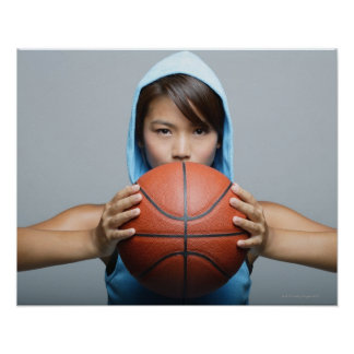 Young woman with basketball looking at camera poster