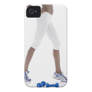 Young woman with dumbbells stretching (low iPhone 4 case