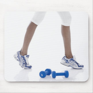 Young woman with dumbbells stretching (low mouse pads
