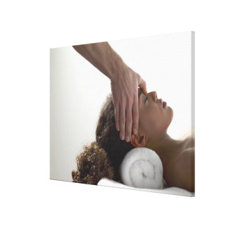 Young women enjoying a massage canvas print