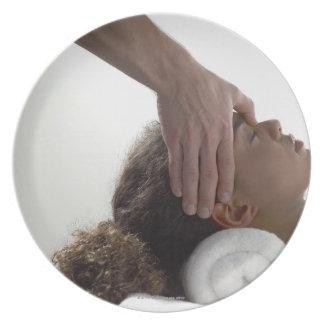 Young women enjoying a massage dinner plate