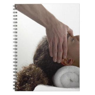 Young women enjoying a massage spiral notebook