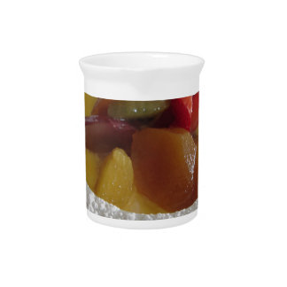 Zabaglione cream with fresh fruit and rolled wafer beverage pitcher