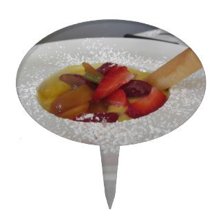 Zabaglione cream with fresh fruit and rolled wafer cake topper