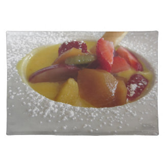 Zabaglione cream with fresh fruit and rolled wafer cloth placemat