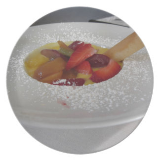 Zabaglione cream with fresh fruit and rolled wafer dinner plate