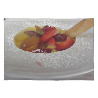 Zabaglione cream with fresh fruit and rolled wafer placemat