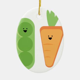 Zanahorias y guisantes adorno navideño ovalado de cerámica