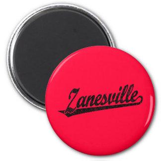 Zanesville script logo in black distressed 2 inch round magnet