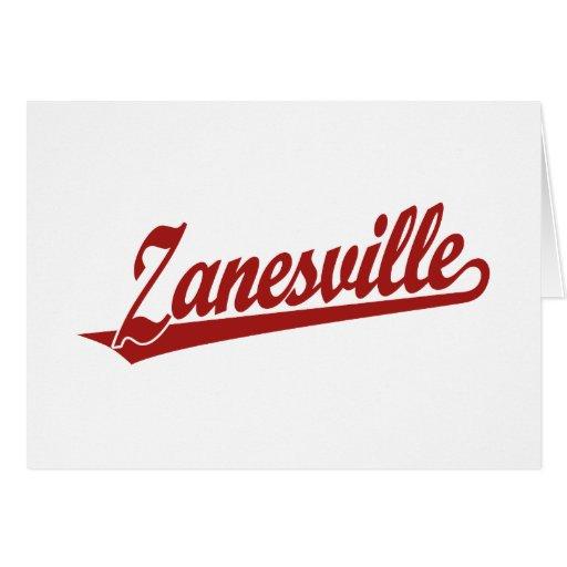 Zanesville script logo in red card