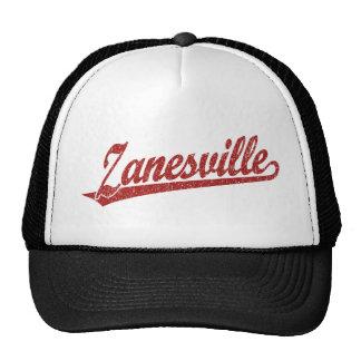 Zanesville script logo in red distressed trucker hat