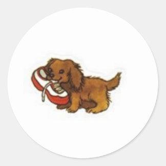 zapatilla de deporte del perrito etiqueta redonda