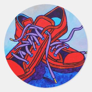 Zapatillas de deporte rojas dos etiqueta redonda