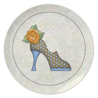 Zapato de la moda en una placa platos para fiestas