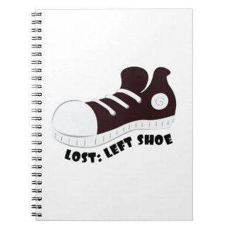 Zapato izquierdo libros de apuntes con espiral
