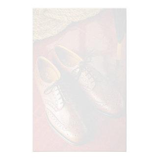 Zapatos atractivos para los caballeros papeleria