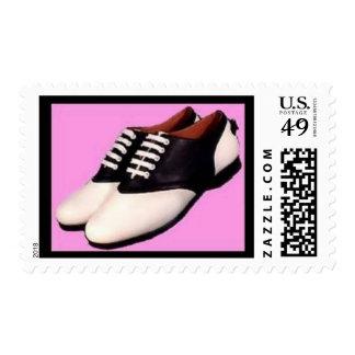 Zapatos de silla de montar retros del ~ 1950 del estampillas