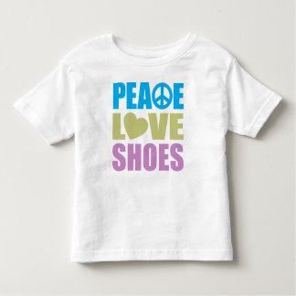Zapatos del amor de la paz playera
