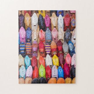 Zapatos exhibidos en una tienda en los souks puzzles con fotos