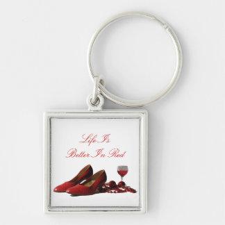 Zapatos rojos del tacón alto y vino rojo llavero cuadrado plateado
