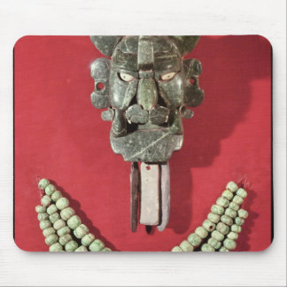 Zapotec pectoral the form of  mask representing mouse pad