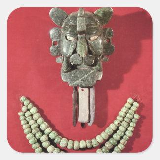 Zapotec pectoral the form of  mask representing sticker