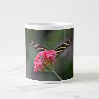zebra butterfly behind pink florida flower extra large mug
